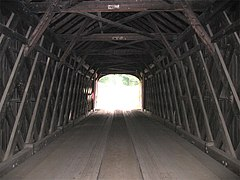 Interior structure of a covered bridge utilizing a plank-lattice structure