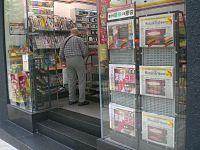 HK Sheung Wan Po Yan Street 7-11 Shop Newspaper Stand.JPG