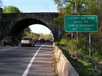 Hutchinson River Parkway - Northbound on the Hutchinson River Parkway in Pelham. Signage is present off the shoulder denoting Anne Hutchinson