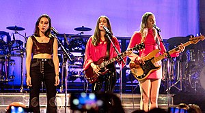 Haim performing in April 2018 From left to right: Alana, Danielle, Este Haim
