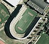 Aerial view of Harvard Stadium in Boston, in the form of a letter U with a capital H in the center of the field and the words Harvard and Crimson at either end