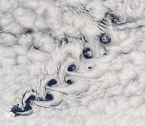 Heard Island and McDonald Islands - Vortex shedding as winds pass Heard Island resulted in this Kármán vortex street in the clouds