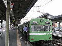 JRW Kansai Main Line JNR 103 local bound for JR Namba at Shin-Imamiya Station.jpg