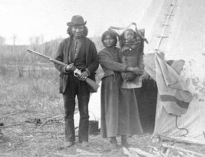 Cradleboard - James Quesace, his wife and their infant in north west Manitoba, Canada, in 1886.