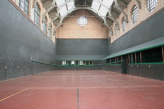 "Real tennis Original ""tennis"" sport; played with racquets in a walled court."