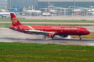 Juneyao Airlines - A Juneyao Airlines Airbus A321-200 landing at Shanghai's Hongqiao International Airport in 2015