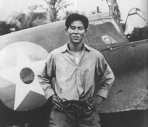 Junichi Sasai - Sasai standing before a crashed Curtiss P-40 in the Dutch East Indies, 1941.