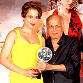 Kangana Ranaut and Mahesh Bhatt posing for the camera