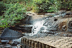 Lingas and sculptures of Hindu gods and waterfall at Kbal Spean