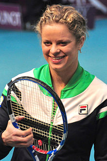 Close-up portrait of Clijsters smiling with her tennis racket