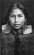 Kwagu'ł girl, Margaret Frank (nee Wilson) wearing abalone shell earrings. Abalone shell earrings were a sign of nobility and only worn by members of this class.