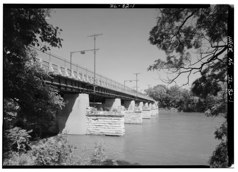 File:LOOKING NORTHEAST, SOUTH SIDE OF PLATE GIRDER BRIDGE WHICH CARRIED THE INTERURBAN LINE ACROSS THE FOX RIVER. NOTE THE STEEL-FRAME SUPPORTS FOR THE CATENARY. - Illinois Traction HAER ILL, 50-OTWA, 7-1.tif