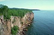 Palisade Head on Lake Superior formed from a Precambrian rhyolitic lava flow.