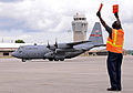 Lawrence Rogers, a transient alert aircraft servicer with the 94th Airlift Wing, marshals a C-130 Hercules aircraft assigned to the 165th Airlift Wing (AW), Georgia Air National Guard, into a parking space 130606-F-AC256-037.jpg