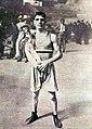 Le boxeur Jean Cès et sa mascotte, aux JO de Paris 1923.jpg