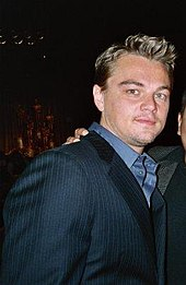 Leonardo DiCaprio is looking directly at the camera.