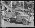 Loading coal into rancher's truck at the mine. Boulder Valley Coal Company, Centennial Mine, Louisville, Boulder... - NARA - 540459.tif