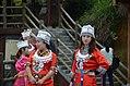 Local schoolgirls in ethnic costume taking selfies (36175087272).jpg