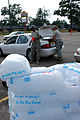 Louisiana National Guardsmen hand out supplies to residents in New Iberia, La. DVIDS112969.jpg