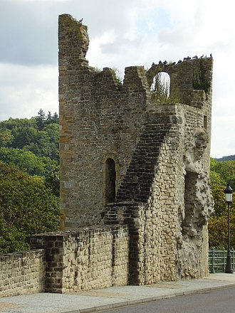 """Fortress of Luxembourg - """"Huelen Zant"""" (Hollow tooth), the remains a tower of one of the fortress gates, on the Bock rock. During the demolition works, after 1871, the tower was only half destroyed and transformed to look like the ruins of a medieval castle."""