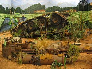 M56 Scorpion - Diorama of destroyed M56 at the AAF Tank Museum. Note the prominent rubber tires on the road wheels.
