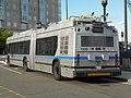 MBTA Neoplan DMA-460LF at Silver Line Way (2), October 2014.jpg