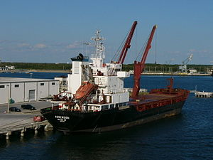 Superstructure - The superstructure of this cargo ship is in the back and includes a lifeboat.
