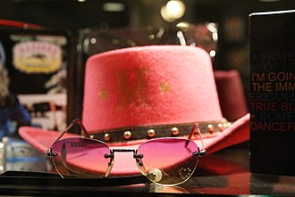 Music (Madonna album) - A cowgirl hat and pink shades, two of the various promotional items produced to support the album's release.
