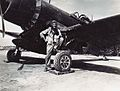 Maj Chamberlain CO VMF-314 with F4U-1C c1945.jpg