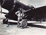 Maj Chamberlain CO VMF-314 with F4U-1C c1945.jpg