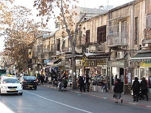 Malkhei Yisrael Street - Morning shoppers pass the stores on Malkhei Yisrael Street.
