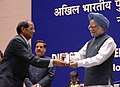 Manmohan Singh gave away the President's Police Medal to Shri Haldhar Mishra, Assistant Director, New Delhi for distinguished services on the occasion of Independence day-2008, at the DGPsIGPs Conference-2008, in New Delhi.jpg