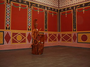 Lenus - Interior of the reconstructed temple on the Martberg, with a cult statue of Lenus Mars.