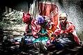 Masai women making beaded bracelets 01.jpg