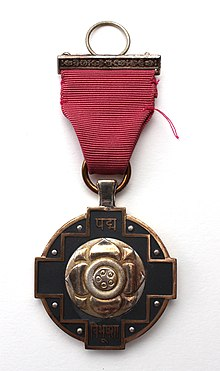 Pictorial depiction of Padma Vibhushan medal in golden colour with its pink ribbon