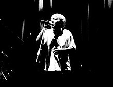 Black and white image of Meshell Ndegeocello singing