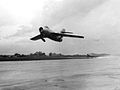 MiG-15 and F-86 Sabre taking off at Okinawa 1953.jpg