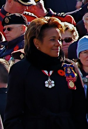 Order of Military Merit (Canada) - Then governor general Michaëlle Jean wearing the Commander's insignia as a brooch, top on her left shoulder, at Remembrance Day ceremonies in Ottawa, 2007