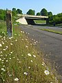 Milestone and daisies by the old A34, Donnington - geograph.org.uk - 813632.jpg