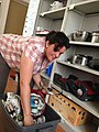 "Monica Wyatt, a relocation assistant with the Army Community Service (ACS) office sorts through items designated for customer use from the ""Lending Closet"" at Pulaski Barracks in Kaiserslautern, Germany 130620-A-UN169-001.jpg"