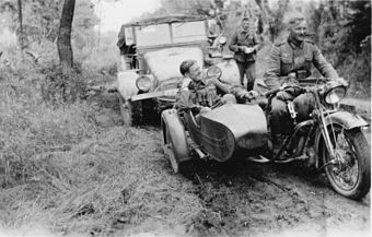 Motorized Wehrmacht soldiers, motorcycle and Krupp Protze.jpg