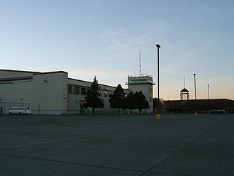 Mount Edgecumbe High School - The B.J. McGillis Field House, a former aircraft hangar, along with the Academic Building, looking northerly from the parking lot