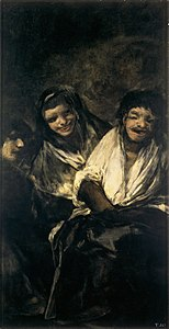 Two women laughing at a man