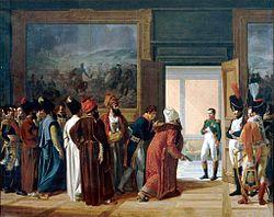 l'ambassadeur de Perse et sa suite en costume persan, présente ses lettres de créances à Napoléon, visible dans l'embrasure d'une porte