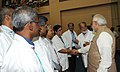 Narendra Modi meeting the scientists after the successful launch of PSLV C23, at the Mission Control Centre, at Sriharikota, in Andhra Pradesh on June 30, 2014. The ISRO Chairman, Dr. K Radhakrishnan is also seen.jpg
