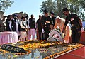 Narendra Modi paying homage to Shaheed Bhagat Singh, Rajguru and Sukhdev at National Martyrs Memorial, at Hussainiwala, in Punjab. The Chief Minister of Punjab, Shri Parkash Singh Badal and other dignitaries are also seen.jpg