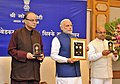 Narendra Modi releasing the commemorative coins on Dr. B.R. Ambedkar, in New Delhi. The Union Minister for Finance, Corporate Affairs and Information & Broadcasting.jpg