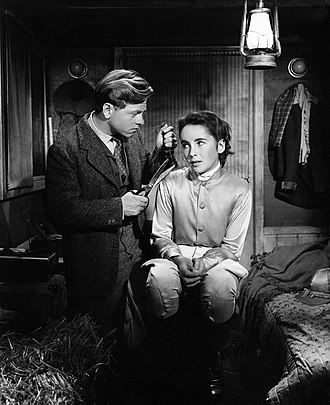 Elizabeth Taylor - Taylor with co-star Mickey Rooney in National Velvet (1944), her first major film role