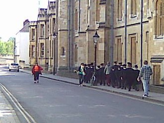 New College School - Choristers from New College School in gowns and mortarboards 'crocodile' to rehearsal in New College