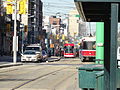 New streetcar 4404 passes old CLRVs, 2014 12 20 (4) (16070801351).jpg